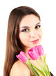 Young beautiful girl with tulips in her hand, isolated on white