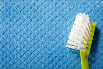 Blue sponge background and brush