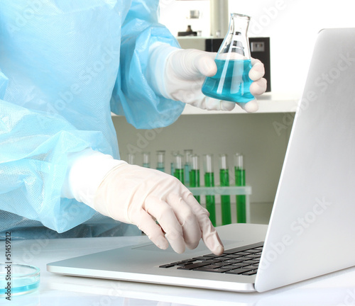 Scientist entering data