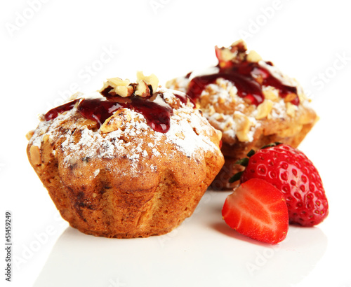 Tasty muffin cakes with strawberries, isolated on white