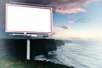 White billboard and cliffs of Moher at sunset