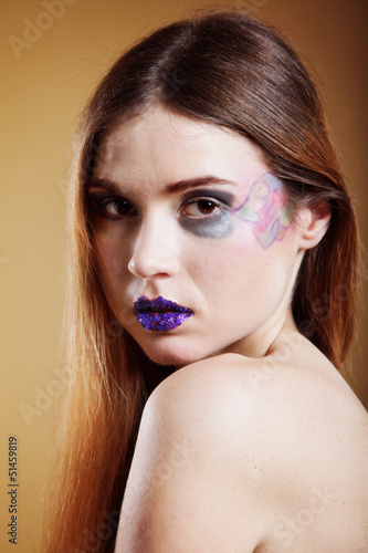 portrait of young beautiful woman creative make up