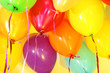 Many bright balloons under ceiling close-up