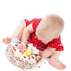 Baby girl and her birthday cake.