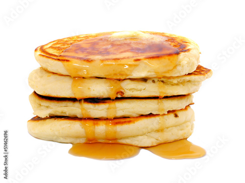 Stack of breakfast pancakes with dripping syrup isolated