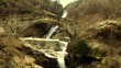 alpine waterfall and ancient bridge