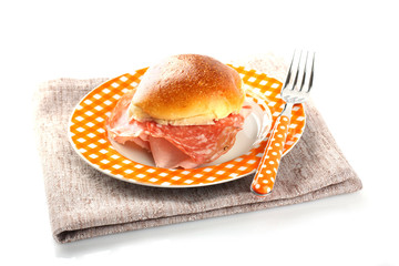 Bread topped with salami and ham