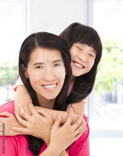 happy asian little girl  with her mother