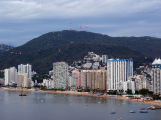 Fancy Tall hotels line beach shore of Acapulco
