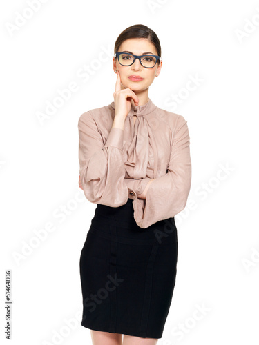 Portrait of  the young serious woman in glasses