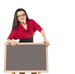 girl with glasses, behind an empty table to show something