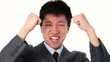 Happy young Asian businessman screaming for joy