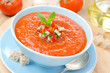 cold tomato soup gazpacho with basil and croutons in a bowl