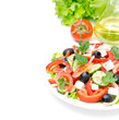 Greek salad with feta cheese, olives and vegetables