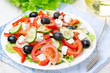 Greek salad with feta cheese, olives and vegetables, horizontal