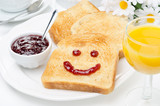 Toast with a smile of jam, coffee, orange juice
