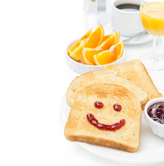 Toast with a smile of jam, coffee, orange juice and fresh orange