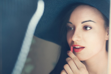 beautiful girl in a hat lipstick