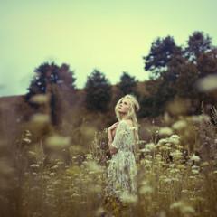 Vintage photo of beautiful girl in spring field