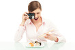 Woman photographing sushi