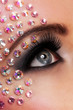 Closeup image of eyes with diamond makeup