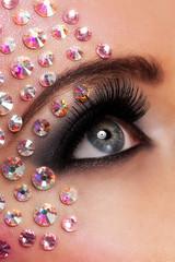 Closeup image of eyes with diamond makeup