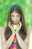 portrait pretty serious woman hands yellow apple