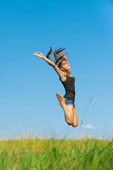 beautiful young woman jumping up