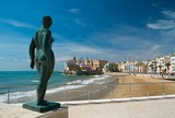 Statue of a naked woman against Sitges town view