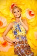 Beautiful young blond woman in colourful dress