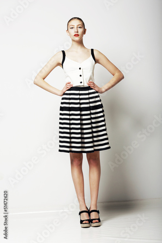 Trendy Woman in Stripped Skirt and T-Shirt. Urban Collection