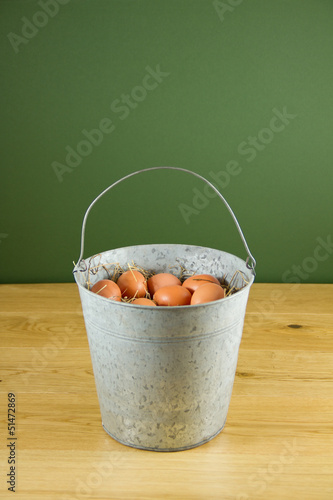 Metal bucket of eggs