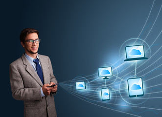 Handsome man typing on smartphone with cloud computing