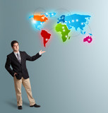 young man presenting colorful world map