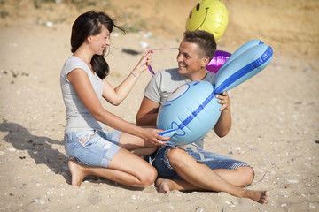 Couple in love at sea beach in honeymoon