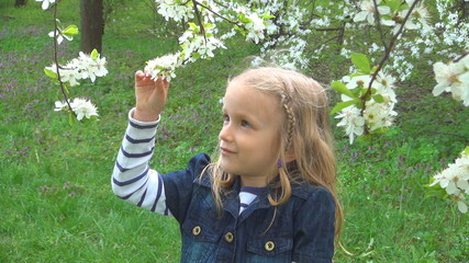 Child Smelling, Playing with Spring Flowers in Park, Children