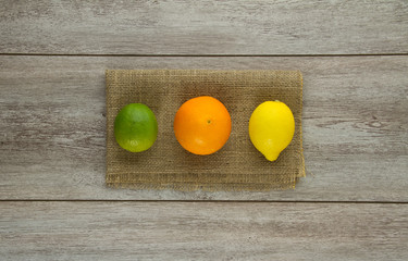 Lime, Orange, Lemon on burlap
