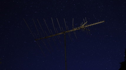 TV antenna and star timelapse.