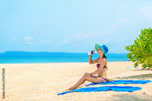 girl with a bottle of water at the beach