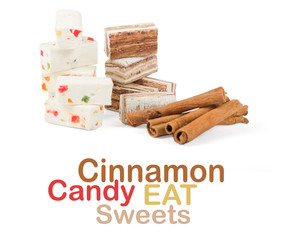 Sweets and cinnamon sticks isolated on white background