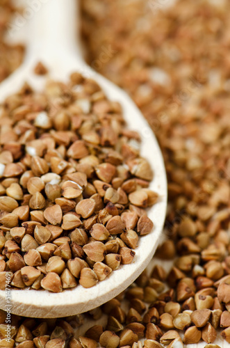 buckwheat groats in wooden spoon