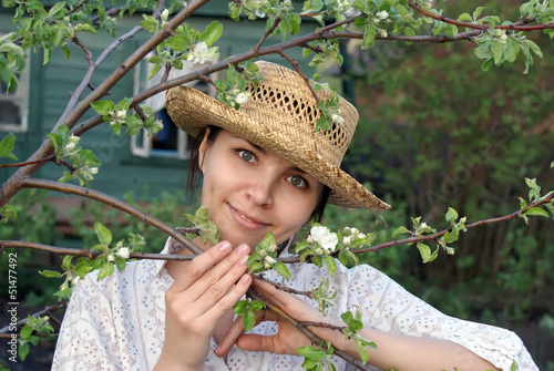 Young woman in spring garden