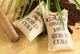Fototapety Burlap sacks of Cuban coffee and a cigar