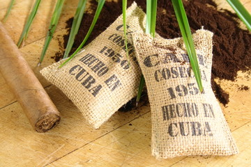 Burlap sacks of Cuban coffee and a cigar