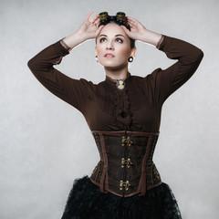 Beautiful woman in steampunk style