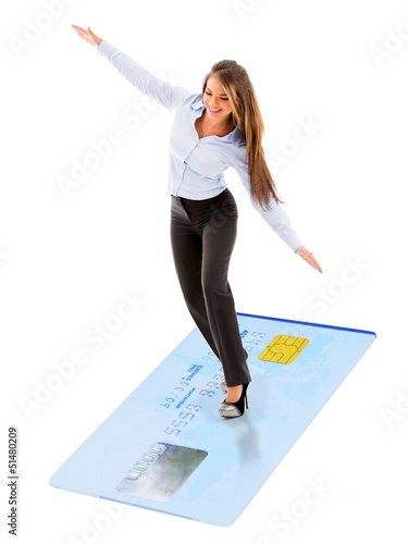Business woman flying on credit card