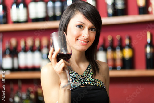 Woman tasting red wine