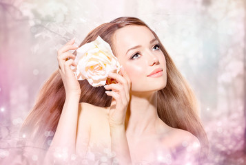 Beauty Girl Portrait. Spring Model with flower
