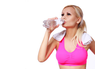 fitness girl with water bottle and towel isolated