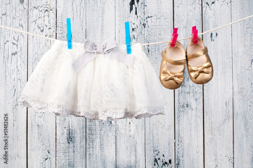 Baby clothes hanging on the clothesline.